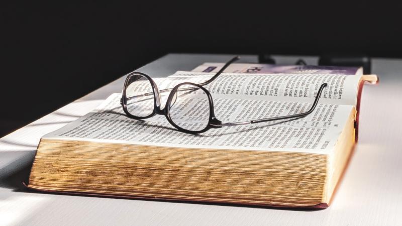 Hoe kan ik een tekst uit een fysiek boek kopiëren?